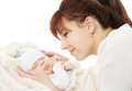 Mother and newborn baby sleeping over white happy holding background Royalty Free Stock Photo