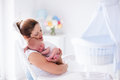 Mother and newborn baby in white nursery Royalty Free Stock Photo