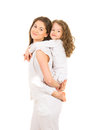 Mother offering piggyback ride to her girl piggy back daughter isolated on white background Stock Photos
