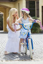 Mother Parent & Girl Child Riding Bike Royalty Free Stock Photography