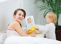 Mother playing with baby in bedroom Royalty Free Stock Photo