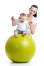 Mother playing with baby on fit ball fitness Royalty Free Stock Photos