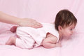 Mother playing with baby on pink Stock Images