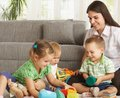Mother playing with children at home Royalty Free Stock Photo