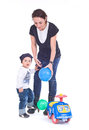 Mother playing with her child mom and son balls and toys Stock Photos