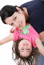 Mother playing with her daughter and holding upside down Royalty Free Stock Image