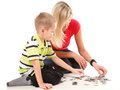 Mother playing puzzle together with her son on floor isolated on white background Royalty Free Stock Photography