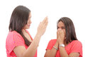 Mother preparing to slap her daughter in the face isolated over white Stock Photography