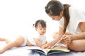 Mother is reading a book for her baby on white background Royalty Free Stock Photos