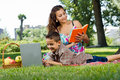 Mother reading a  book in park Royalty Free Stock Image