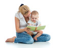 Mother reading book to baby a her boy Stock Photos
