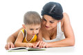Mother reading a book to her kid boy Stock Image