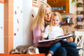 Mother reading night story to kid at home tired daughter good out of storytelling book Royalty Free Stock Photo