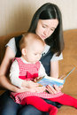 Mother reading to daughter Royalty Free Stock Image