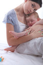 Mother rocking her baby to sleep Royalty Free Stock Images