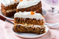 Mother s day carrot cake with swirls cream cheese frosting homemade moist and sweet layer grated walnuts and dried apricot topped Royalty Free Stock Photos