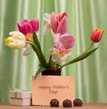 Mother s day concept bouquet of fresh spring flowers and a gift Stock Photo