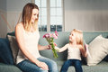 Mother`s Day. Woman and Child with Flowers and Gift Card Royalty Free Stock Photo