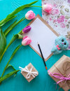Mother`s Day, woman`s day. tulips , letter and presents on wooden background Royalty Free Stock Photo