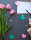 Mother`s Day, woman`s day. tulips ,presents and letter on wooden background Royalty Free Stock Photo