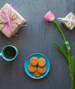 Mother`s Day, woman`s day. tulips ,presents ,tea and sweets on wooden background Royalty Free Stock Photo