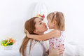Mother s love and years old daughter kissing in the bedroom Royalty Free Stock Photography