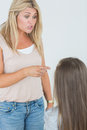Mother scolding her daughter daugher and pointing Royalty Free Stock Images