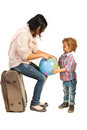 Mother showing her son on world globe sitting baggage and to his destination a Royalty Free Stock Image