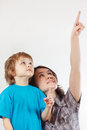 Mother shows his hand up to her little son Royalty Free Stock Image