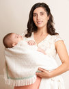 Mother with sleeping baby portrait, happy maternity concept, yellow toned Royalty Free Stock Photo