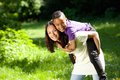 Mother smiling outdoors with happy son Royalty Free Stock Photo