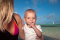 Mother and son along the ocean woman smiling blond blue eyed boy tropical beach Royalty Free Stock Photos