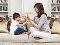 Mother and son asian having fun at home Stock Photo