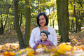 Mother son autumn smiling and at a park in the Royalty Free Stock Images