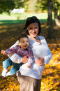 Mother son autumn smiling and at a park in the Stock Photos