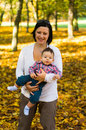 Mother son autumn smiling and at a park in the Royalty Free Stock Image