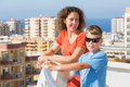 Mother and son on the balcony Royalty Free Stock Photo