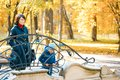The mother and son on the bridge. mother with baby son standing outdoors. Royalty Free Stock Photo
