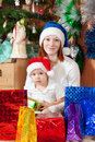 Mother and  son with Christmas gifts Stock Photo