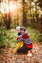 Mother and son communicate park cuddling fall Royalty Free Stock Photo