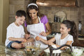 Mother Son Daughter Family Baking In A Kitchen Royalty Free Stock Image
