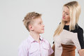 Mother and son with disheveled hair look at each other blond a in the studio Royalty Free Stock Image