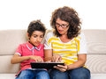 Mother and son doing homework digital tablet pc boy with sitting on sofa at home isolated on white Royalty Free Stock Photo