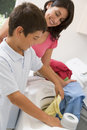 Mother And Son Doing Laundry Stock Image