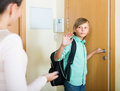 Mother with son at doorway Royalty Free Stock Photo