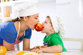 Mother and son eating together red fresh apple Royalty Free Stock Photo