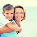 Mother and son in embrace on the beach closeup portrait of happy Royalty Free Stock Images