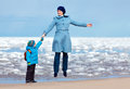 Mother and son enjoying time at winter beach see my other works in portfolio Stock Photos