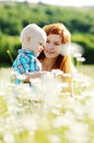 Mother and son in field daisy Stock Photo