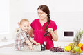 Mother and son with fruits in the kitchen child Stock Image